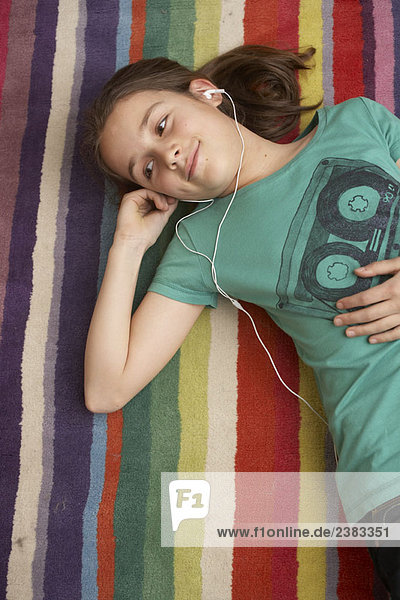 Girl listening to music on mp3 player