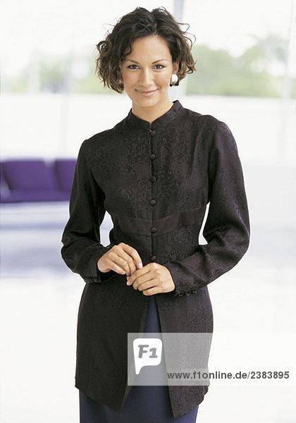 Mid adult woman smiling at camera
