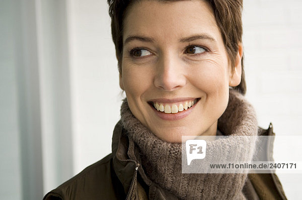 Close-up of a mid adult woman smiling
