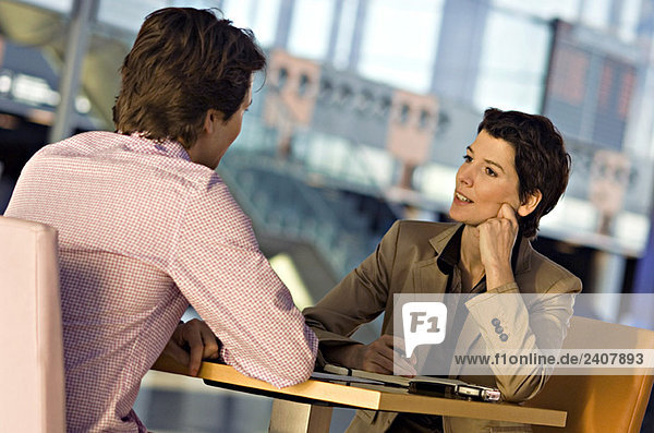 Businessman and a businesswoman in a meeting