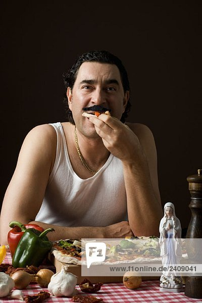 Stereotypical Italian Man eating pizza