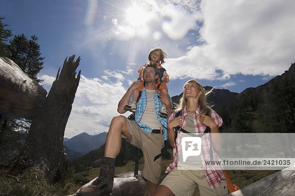Austria,  Salzburger Land,  couple with son (8-9) hiking