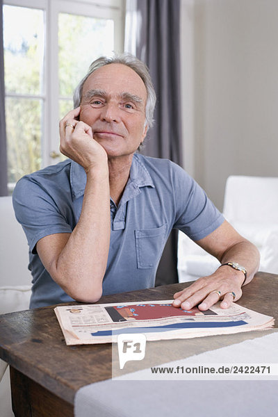 Senior man sitting at table  portrait