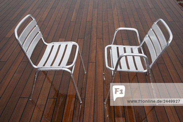 two chairs on deck of cruise ship