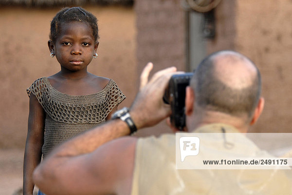 Africa  Burkina Faso  photographer taking boy picture
