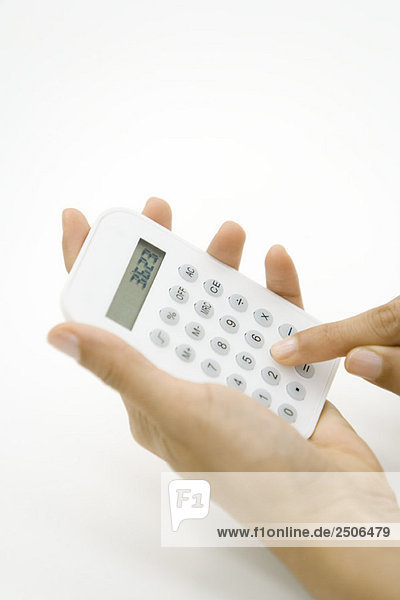 Person using calculator  cropped view of hands