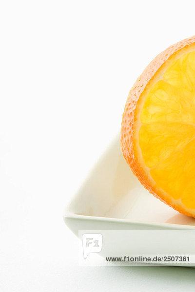 Orange slice in small dish  close-up