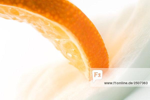 Orange slice on cotton cosmetic pad  close-up