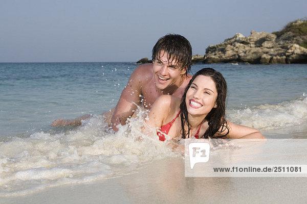 Asia  Thailand  Couple lying on beach