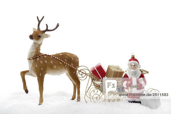 Weihnachtsschmuck  Weihnachtsmann mit Schlitten