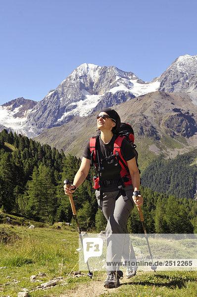 Female hiker walking on landscape  Trentino-Alto Adige  Italy