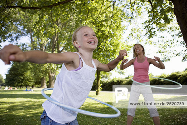 Mother and daughter with hula-hoop