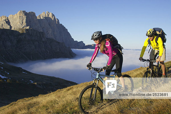 Two bicyclists in the mountains