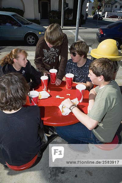 Group of teens at fast food restaurant