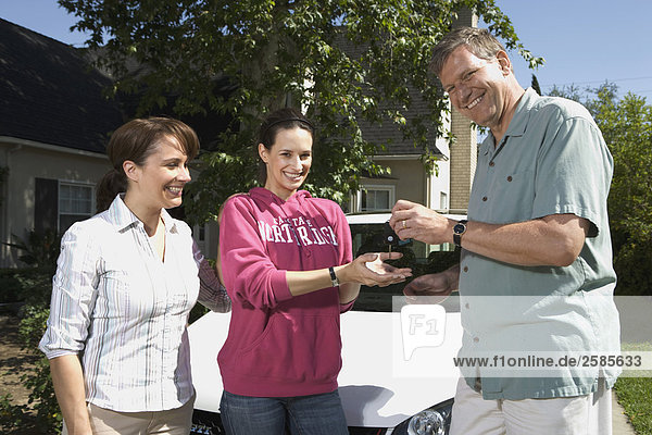 Parents giving daughter keys to VW GTI