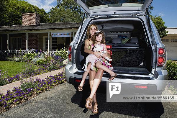 sitzend Tochter Pilot Honda Mutter - Mensch Welpe