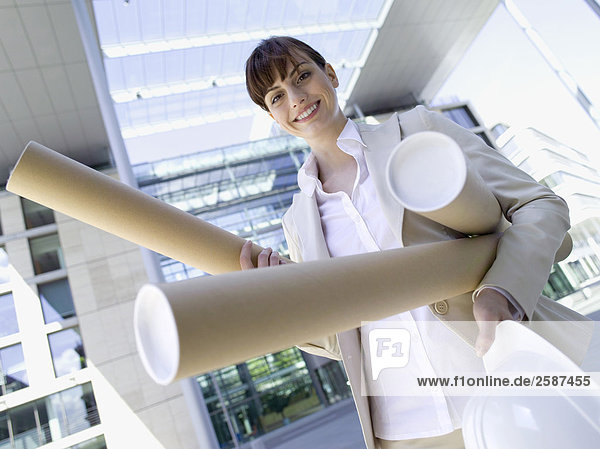 businesswoman with building plans  low angle view