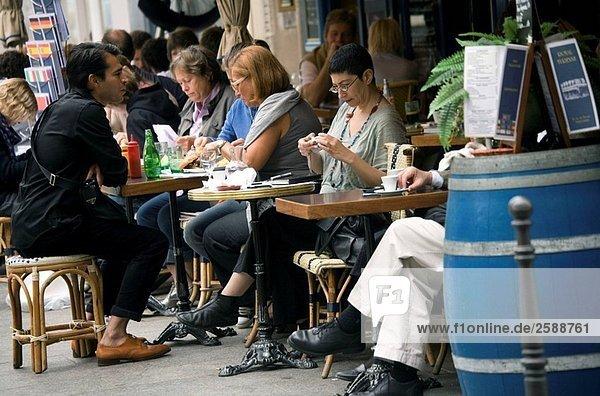 France. Paris. People at brasserie terrace at rue de Turenne