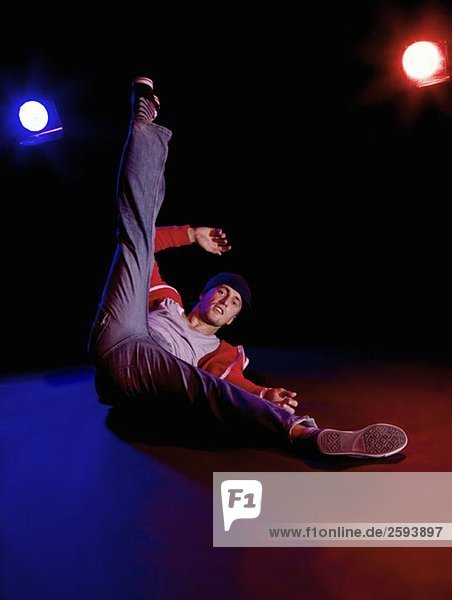A B-boy doing a Freeze breakdance move