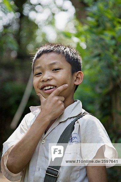 Portrait of a young boy after school in Luang Prabang Laos