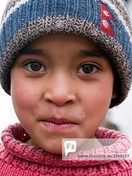portrait of cute Nepali girl with big eyes on the Singalila Ridge along the Nepal India border