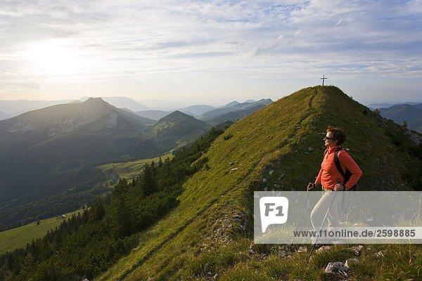 Female hiker standing on mountain  Osterhorngruppe Schmittenstein  Salzach valley  Austria