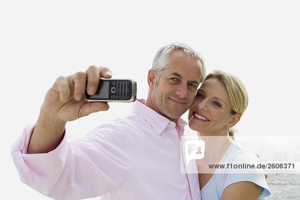 Mature couple taking self portrait with camera phone