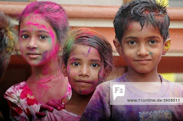 Panjim Goa  India  children with colored powder on the faces during the Holi feast