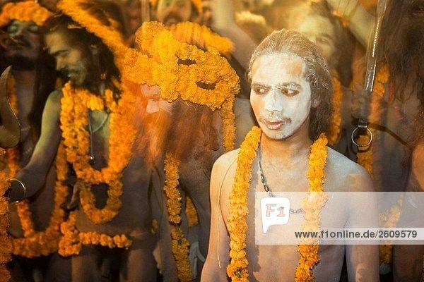 Naga Sadhus preparing for bathing in The holy river Ganges at Kumbh Mela Festival. Allahabad  Uttar Pradesh  India