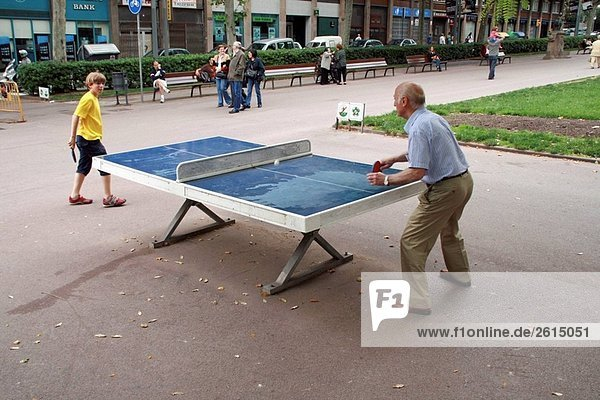 People playing table tennis at Passeig de Sant Joan  Barcelona. Catalonia  Spain