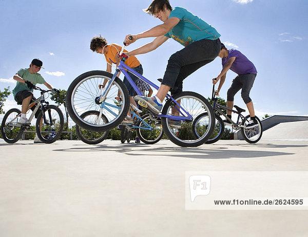 Teen boys riding bikes