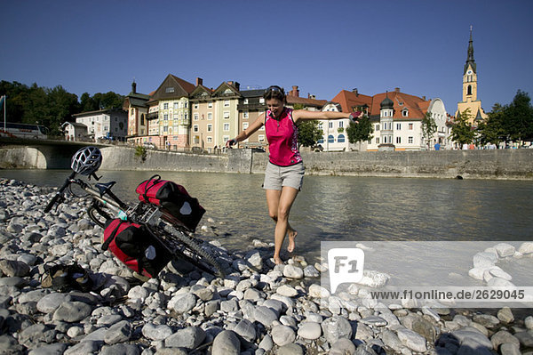 Bad Toelz  Woman fooling about on shore