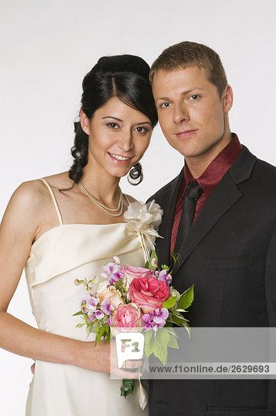 Portrait von Braut und Bräutigam an ihrem Hochzeitstag