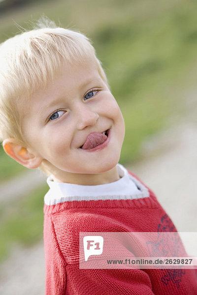Little boy (3-4) poking his tongue out  portrait