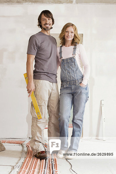 Young couple in an unfinished building  portrait