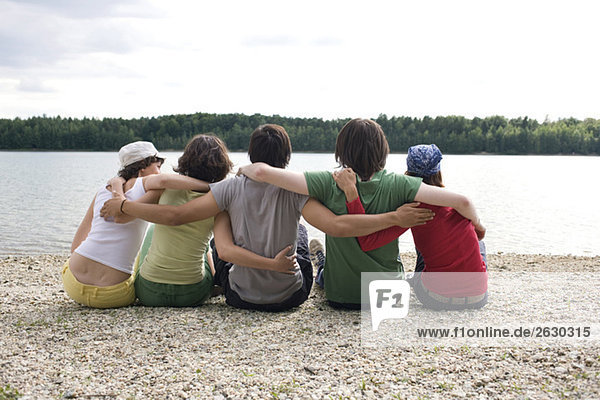 Germany  Leipzig  Ammelshainer See  Five persons stting near lake