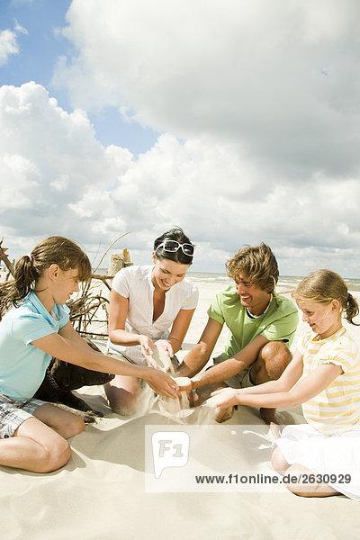 kids building sand castle