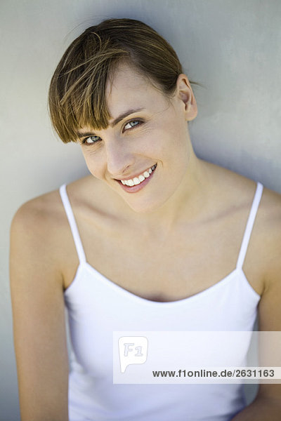 Woman smiling at camera  portrait  high angle view