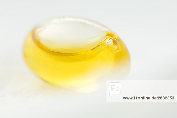 Yellow liquid inside of egg-shaped container  close-up