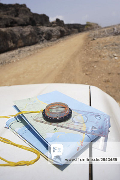 compass and map on car on desert road