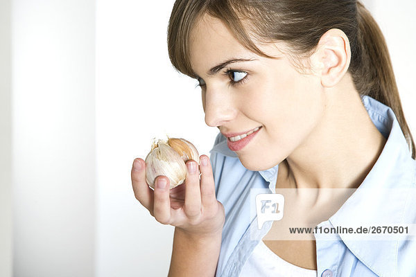 Woman smelling Knoblauch