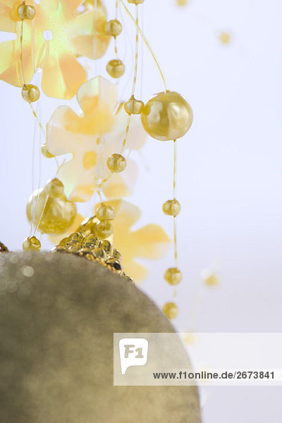 Gold ornament and decorative garland  close-up