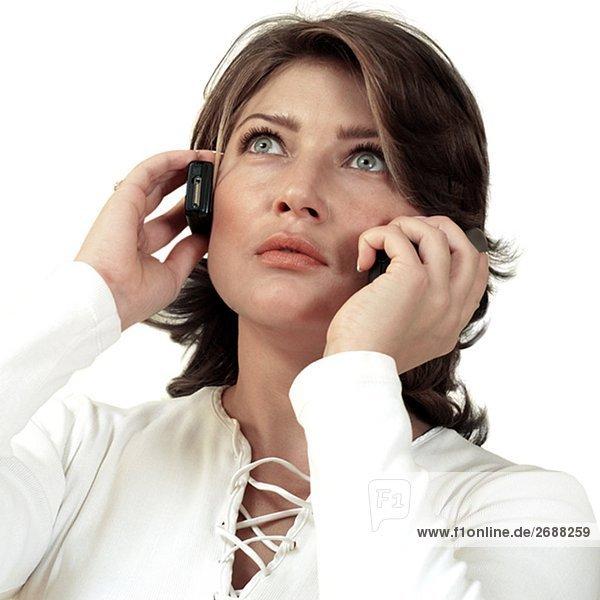 Nahaufnahme der geschäftsfrau mit zwei Handys