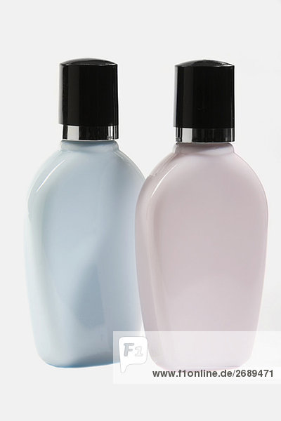 Close-up of two moisturizer bottles