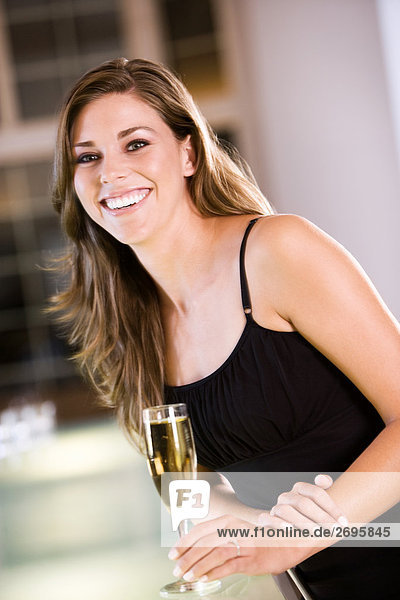 Portrait of a young woman holding a champagne flute