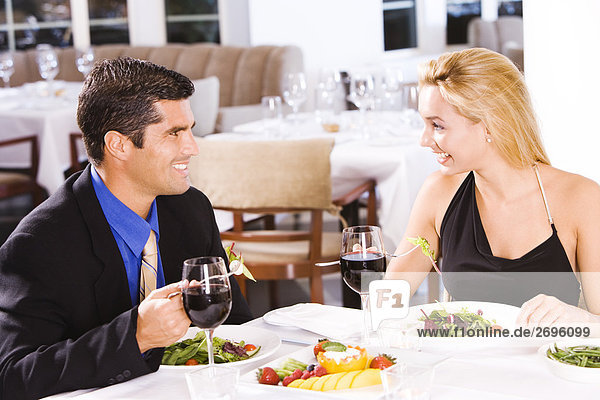 Mid adult man and a young woman sitting in a restaurant