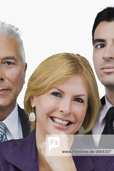 Portrait of a businesswoman smiling with two businessmen beside her