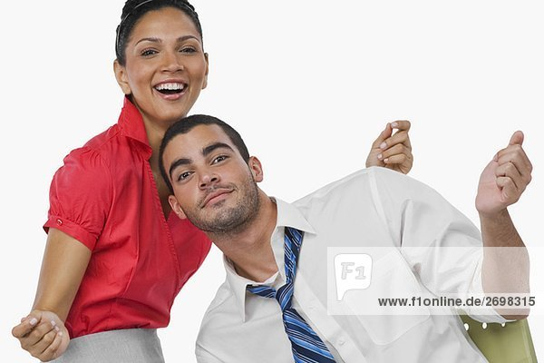 Portrait of a businesswoman and a businessman dancing together