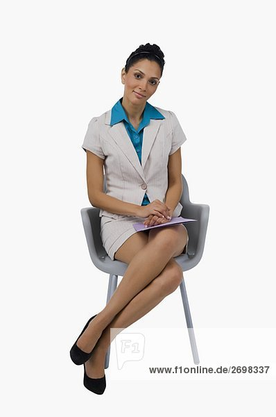 Portrait of a businesswoman sitting on a chair