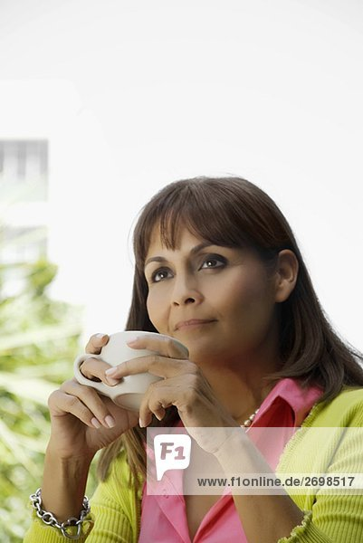 Close-up of a mature woman holding a coffee cup